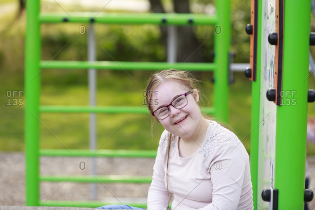 Smiling girl on playground looking at camera