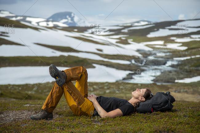 Female hiker resting. Detailed shot.
