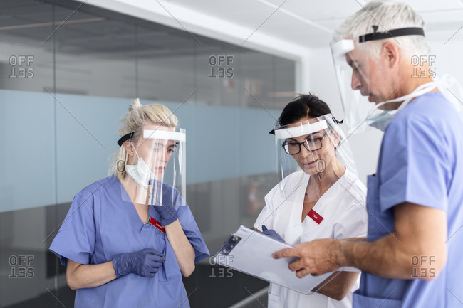 Doctors wearing personal protective equipment in hospital