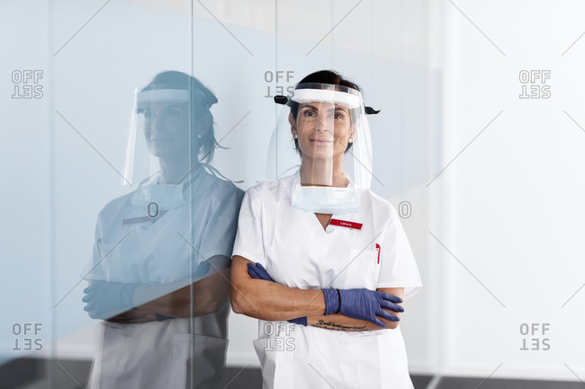 Female doctor wearing personal protective equipment