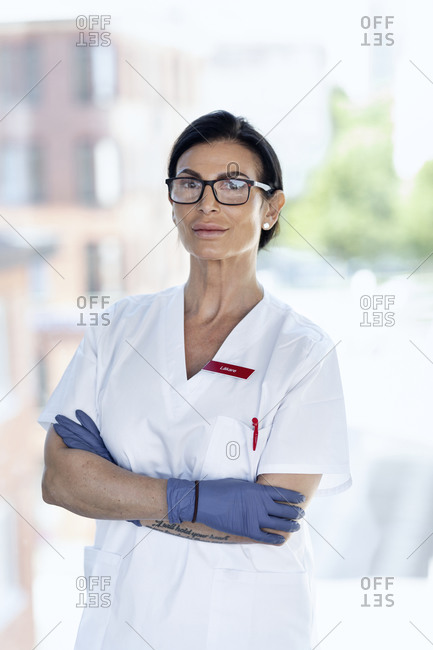 Female doctor looking at camera. Detailed shot.