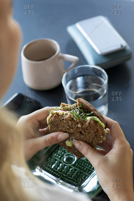 Womans hands holding sandwich. Detailed shot.