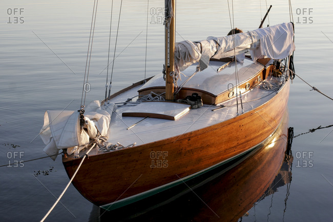 View of moored wooden sailing boat