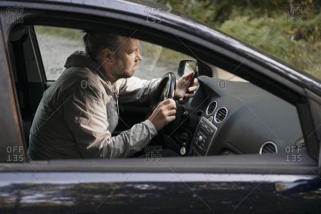 Man driving car. Detailed shot.