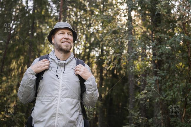 Smiling male hiker looking away. Detailed shot.