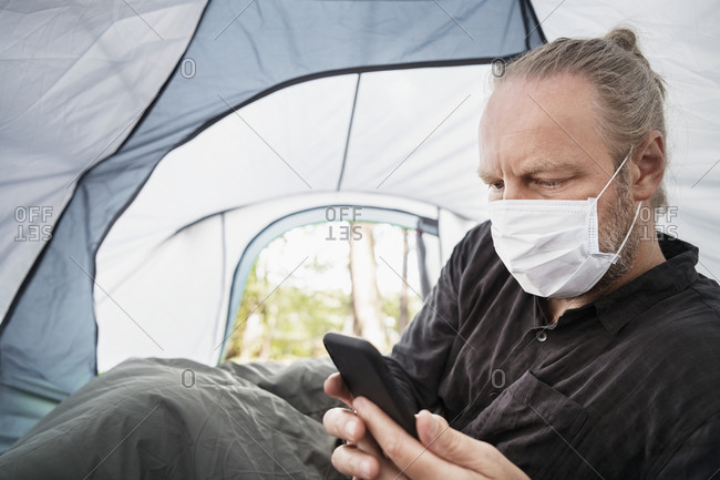 Man wearing face mask in tent