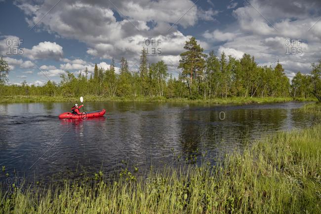 Person kayaking on river. Detailed shot.