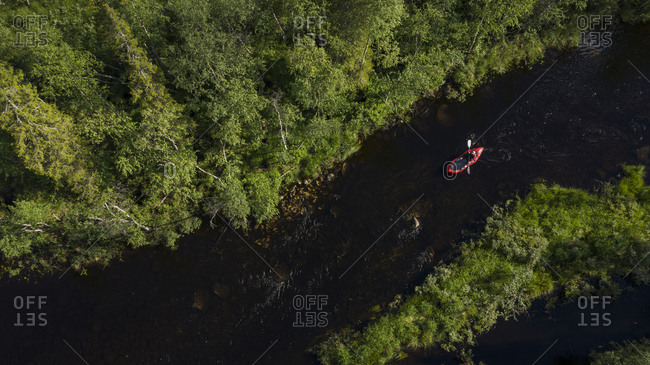 Aerial view of person kayaking on river