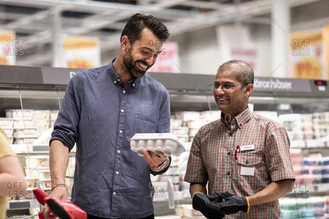 Client talking to shop assistant. Detailed shot.