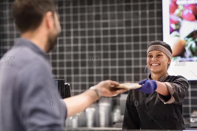 Smiling female shop assistant. Detailed shot.