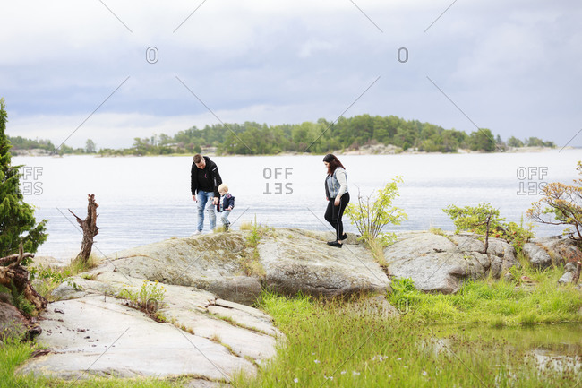 Family with toddler on walk at lake