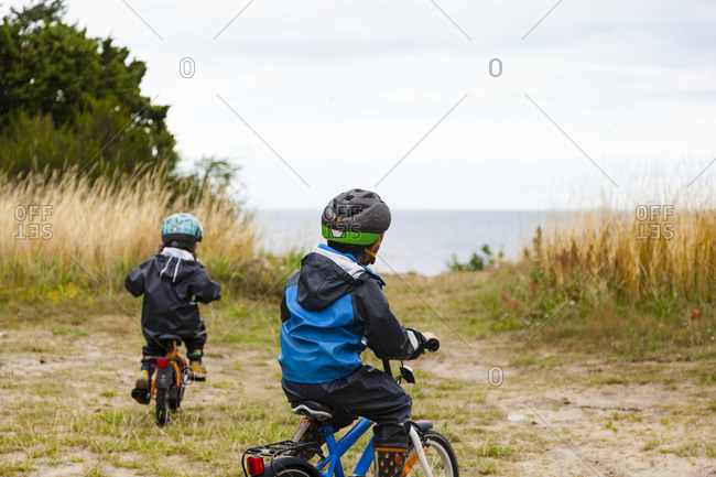 Children cycling at sea. Detailed shot.