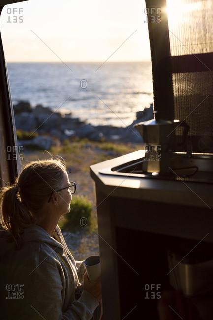 Woman at sunset looking at view