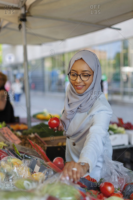 Woman wearing hijab doing shopping. Detailed shot.