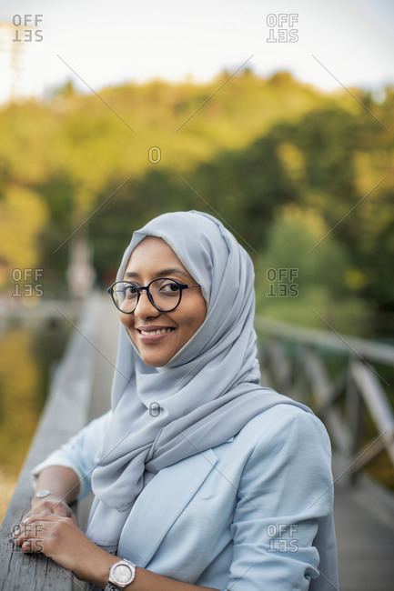 Smiling woman wearing hijab looking at camera