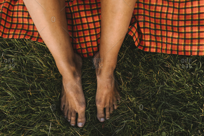 High angle view of bare feet on grass