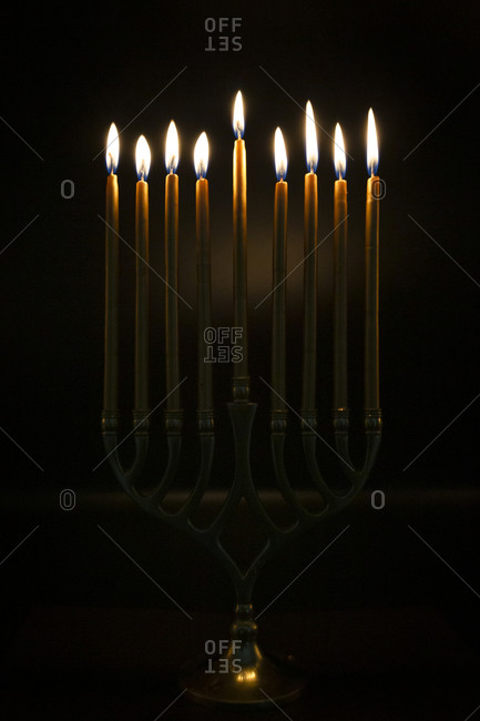 Gold Candles lit in Hanukah Menorah
