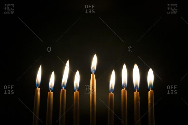 Close-up of Burning Golden Hanukah Candles