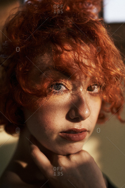 Young alternative redhead girl close up with green eyes