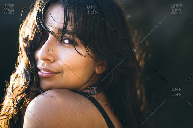 Young Latina Woman portrait at golden hour in summertime