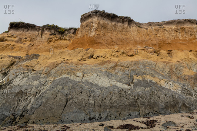 Seaside cliff showing different colors and textures in California