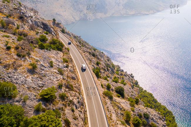 Aerial view of a car driving along the coastal landscape, Croatia
