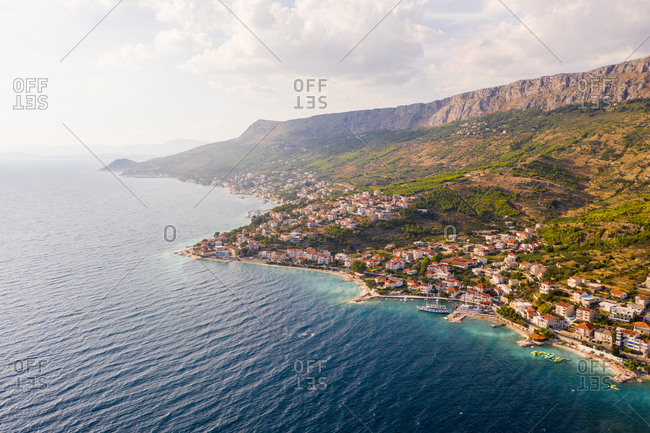 Aerial view of Dugi Rat costal city during a scenic sunset, Croatia