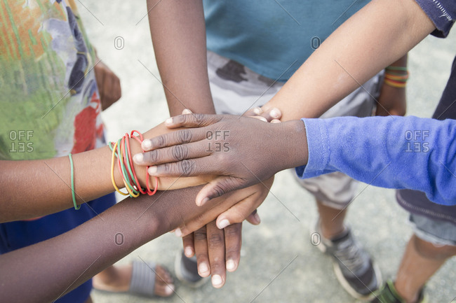 Anonymous group of children of various ethnicities putting their hands together