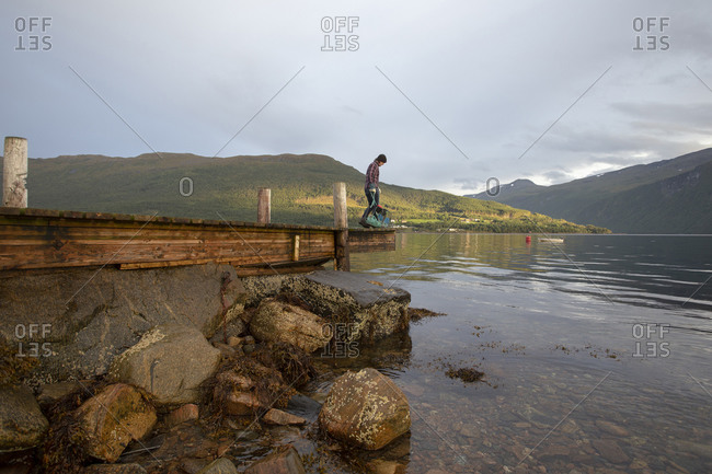 A man planning to drop some crab pots in the fjord