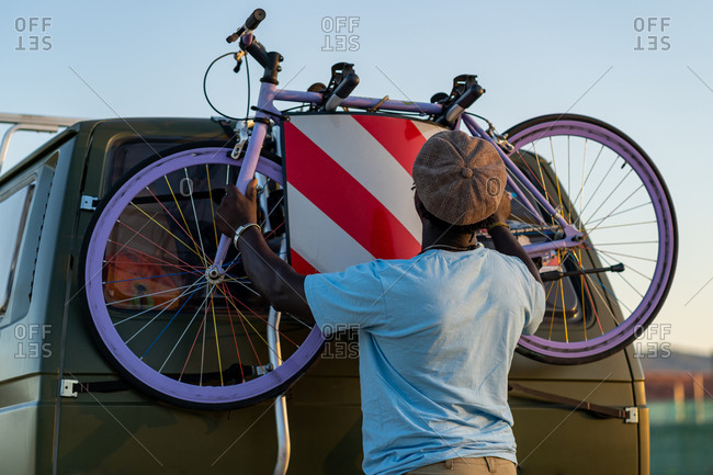 African American man with an old-fashioned bicycle in his van