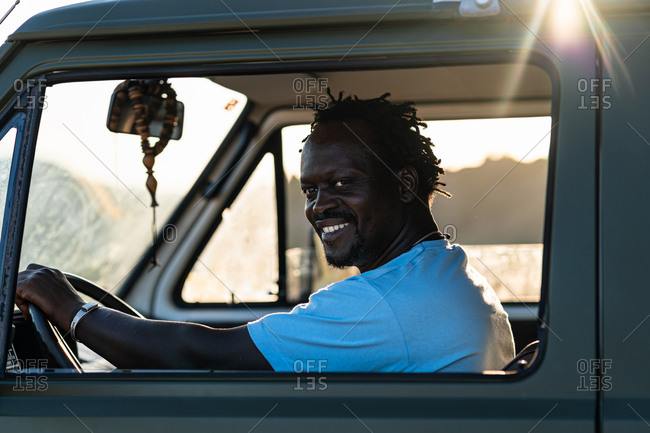 Portrait of smiling afro American man driving