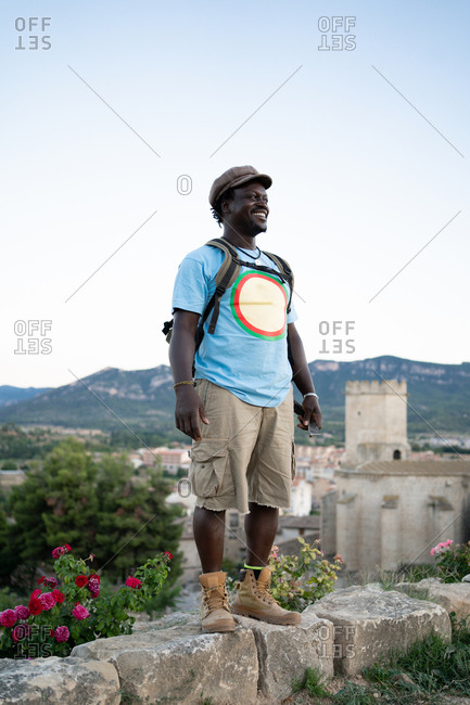 Black African American man with green backpack