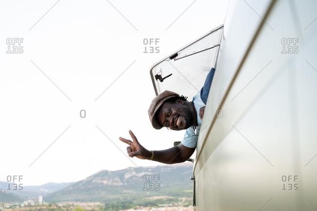 African American black man smiling in his green camper van