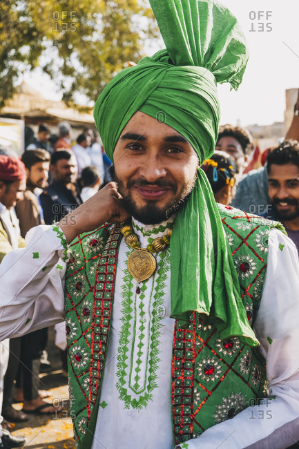 Rajasthan, India - January 29, 2018: Indian dancer dressed in colorful garment during the parade Jaisalmer Desert Festival
