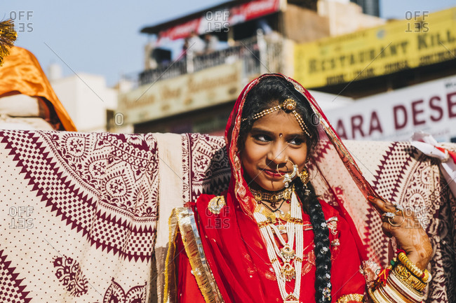 Rajasthan, India - January 29, 2018: Young Indian woman dressed in red colorful saree during Jaisalmer Desert Festival