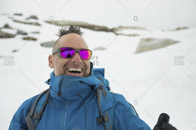 Mountain climber, Adam Palmer, laughing outdoors.