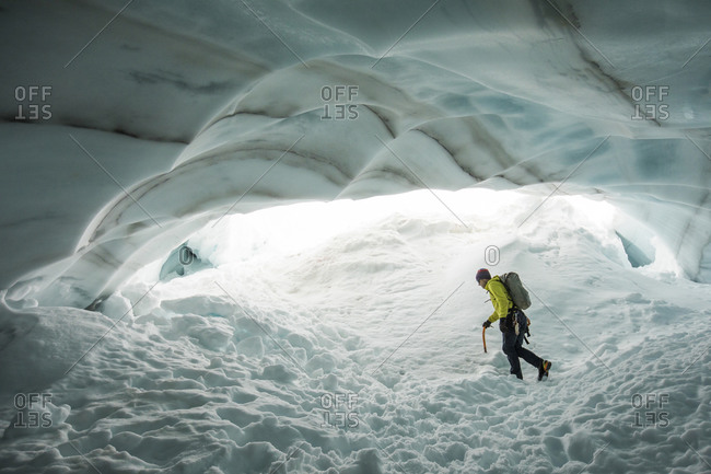 Adventurous explorer hikes though glacial ice cave near Vancouver, B.C