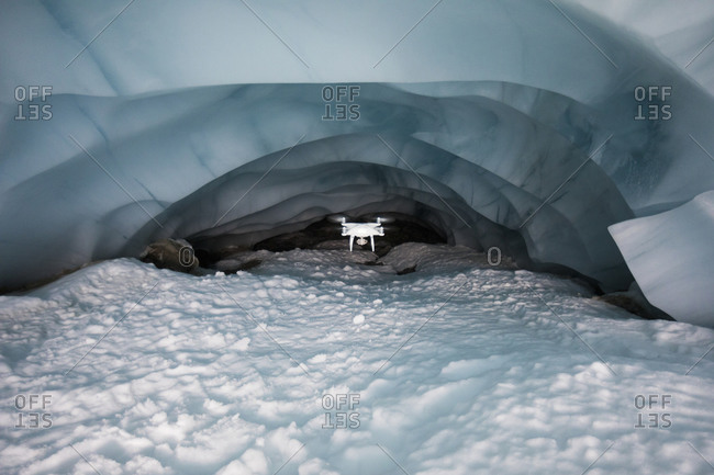 Drone flies deep into glacier cave to document climate change.