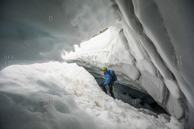 Mountaineer climbs out of glacial cave near, Coast Mountains, B.C.