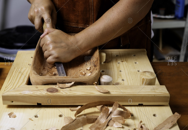 Craftswoman working with Wooden tray