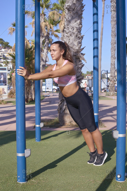 Young woman exercises in a city park