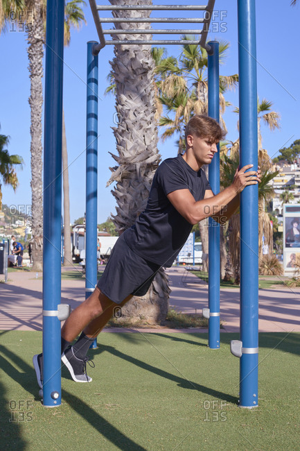 young man exercises in a city park