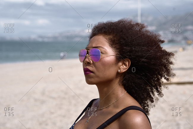 Portrait of a black ethnic woman with hair blown by the wind