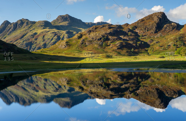 Reflections of the Langdales in Blea Tarn in the English Lake District, UK