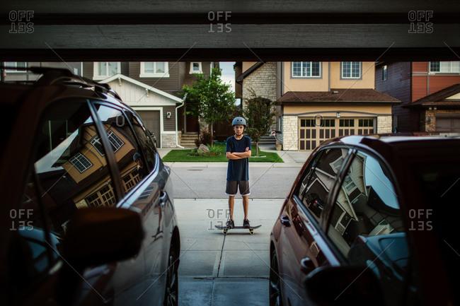Teen boy on skateboard from garage