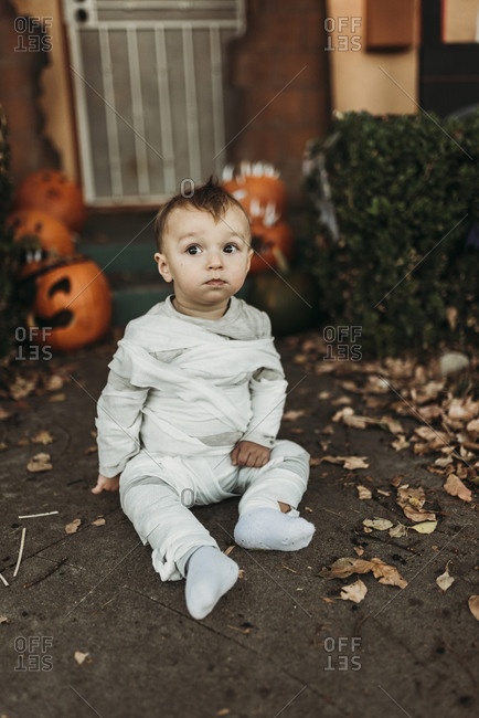 Adorable toddler boy dressed up as mummy on Halloween Trick-or-Treat