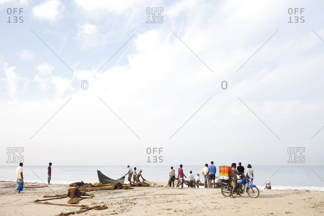 Varkala, India - April 3, 2008: Indian fishermen collect today's catch on the beach