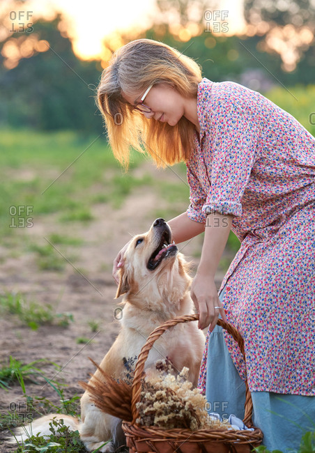 Woman and dog in the rural farm