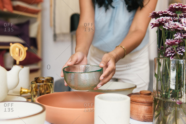 Woman's hands with shallow depth holding artisanal glass bowl