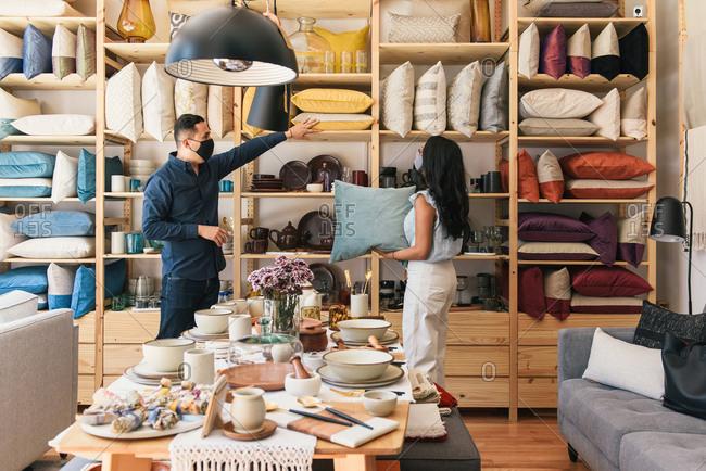Entrepreneur showing customer collection of handmade artisan goods